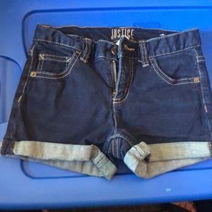 Justice cuffed dark denim jean shorts.